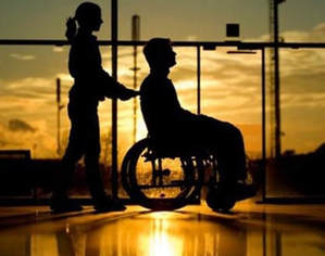 Medical professional assisting someone is a wheelchair